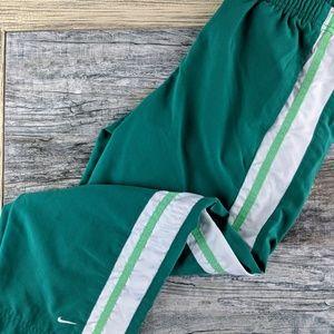 Nike green track pants/ capris size small